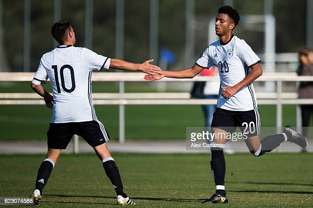 Romario Rosch of Germany congratulates his teammate Timothy Tillman during the U18 international friendly match between Ireland and Germany on...