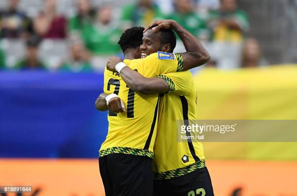 Romario Williams of Jamaica celebrates with teammate Jermaine Taylor after scoring a second half goal against Canada in a quarterfinal match during...