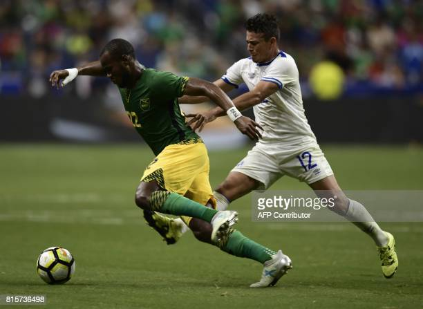Romario Williams of Jamaica is pursued by Narciso Orellana of El Salvador during their CONCACAF Gold Cup match at the Alamodome on July 16 2017 in...