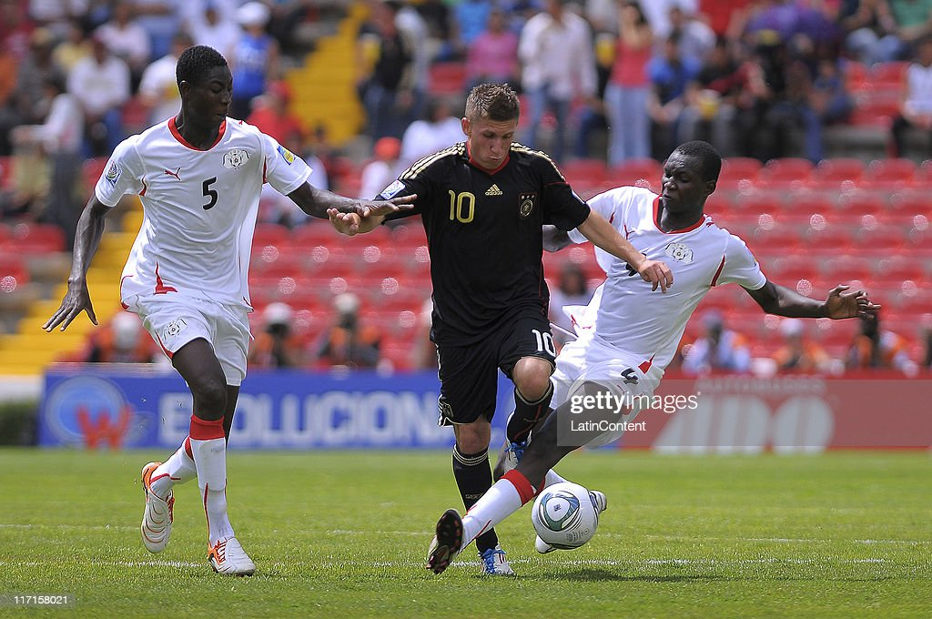 Romariv Bande (L) and Aziz Kabore (R) of Burkina Faso struggles for the ball with Levent Aycicek (C) of Germany during the FIFA U-17 World Cup Mexico 2011 Group E match between Burkina Faso and Germany at the Corregidora Stadium on June 23, 2011 in Queretaro, Mexico.