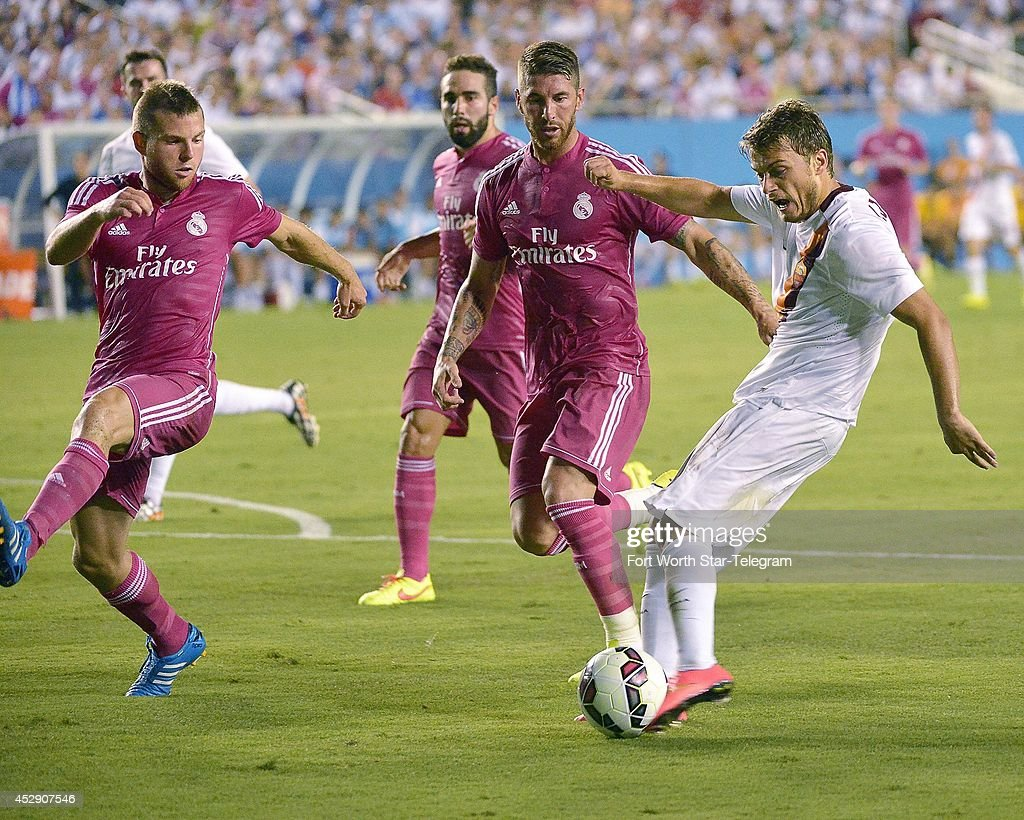 AS Roma's Adem Ljajic, right, shoots as Real Madrid's Sergio Ramos Asier Illarradendi defend during the first half in the Guinness International Champions Cup at the Cotton Bowl in Dallas on Tuesday, July 29, 2014.