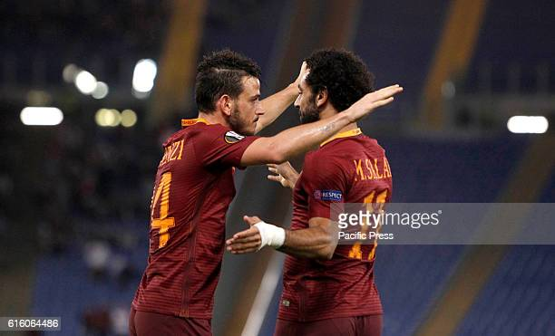 Roma's Alessandro Florenzi left celebrates with teammate Mohamed Salah after scoring during the Europa League Group E soccer match between Roma and...
