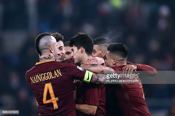 Roma's Argentinan midfielder Diego Perotti celebrates with teammates after scoring a penalty kick during the italian Serie A football match between...
