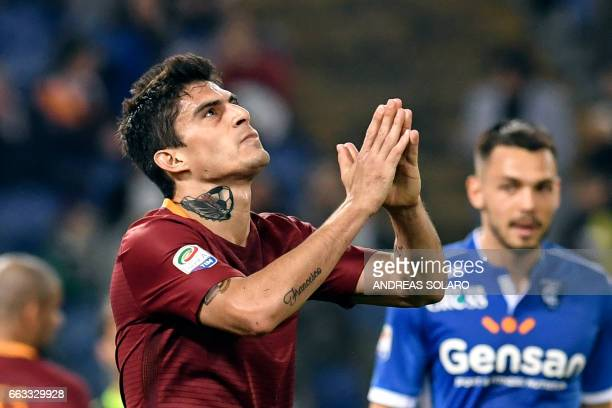 AS Roma's Argentinan midfielder Diego Perotti reacts after missing a goal during the Italian Serie A football match AS Roma versus Empoli on April 1...