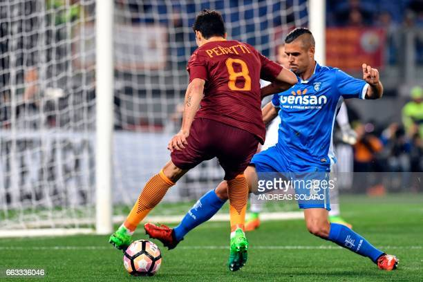 AS Roma's Argentinan midfielder Diego Perotti vies for the ball with Empoli's French defender Vincent Laurini during the Italian Serie A football...