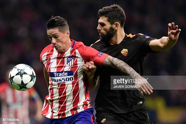 Roma's Argentinian defender Federico Fazio challenges Atletico Madrid's Spanish forward Fernando Torres during the UEFA Champions League group C...