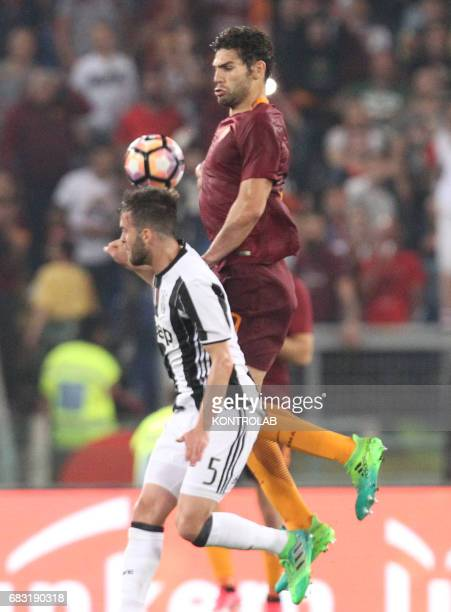 Roma's Argentinian defender Federico Fazio fights for the ball with Juventus' midfielder from Bosnia ed Erzegovina Miralem Pjanic during the Italian...