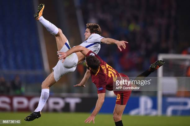 Roma's Argentinian defender Federico Fazio fights for the ball with Chelsea's Spanish defender Marcos Alonso during the UEFA Champions League...