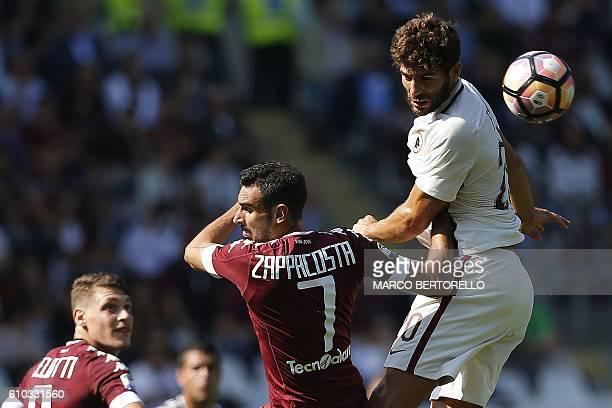 AS Roma's Argentinian defender Federico Fazio heads the ball next to Torino's Italian defender Davide Zappacosta during the Italian Serie A football...