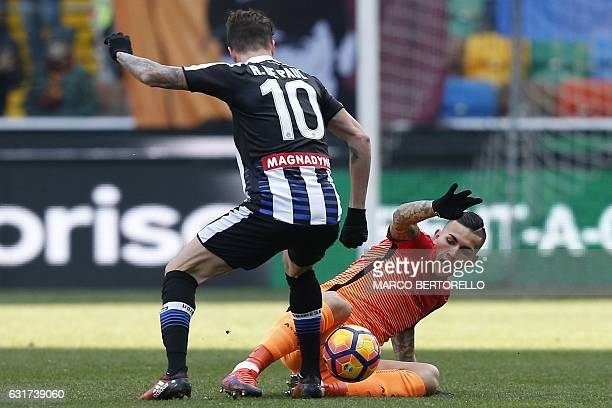 AS Roma's Argentinian defender Leandro Paredes fights for the ball with Udinese's Argentinian midfielder Rodrigo Javier De Paul during the Italian...