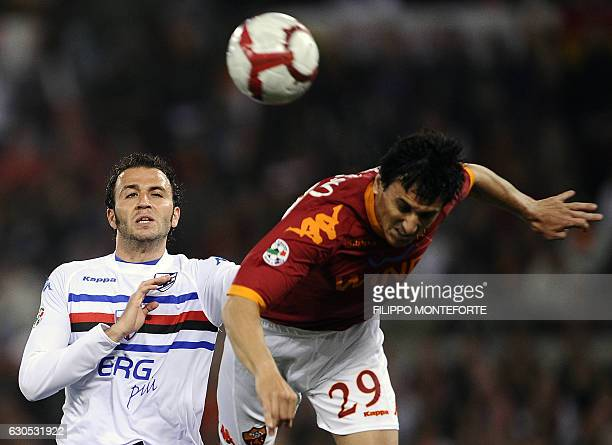 AS Roma's argentinian defender Nicolas Burdisso vies with Sampdoria's forward Nicola Pazzini during their Serie A football match in Rome's Olympic...