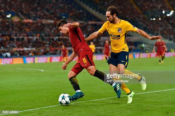 Roma's Argentinian forward Diego Perotti outruns Atletico Madrid's defender Juanfran during the UEFA Champions League Group C football match between...