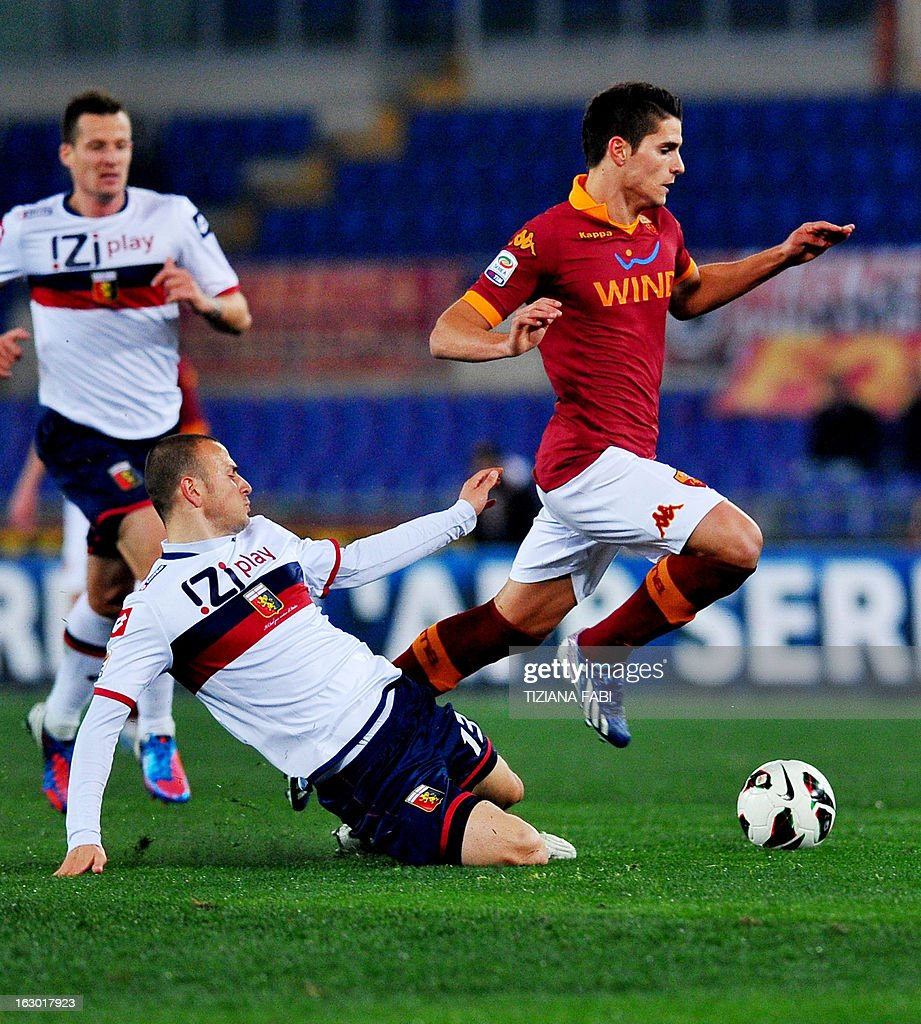 AS Roma's Argentinian forward Erik Lamela (R) vies for the ball with Genoa's defender Luca Antonelli (C) during the Italian Serie A football match AS Romsa vs Genoa at Olympic Stadium on March 3, 2013 in Rome.