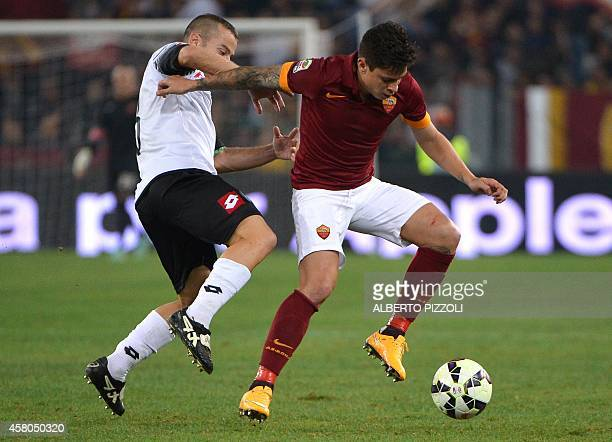 AS Roma's Argentinian forward Juan Manuel Iturbe fights for the ball with Cesena's midfielder Giuseppe De Feudis during the Italian Serie A football...