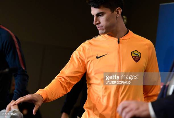 Roma's Argentinian midfielder Diego Perotti arrives to give a press conference at the Wanda Metropolitan stadium in Madrid on November 21 2017 on the...