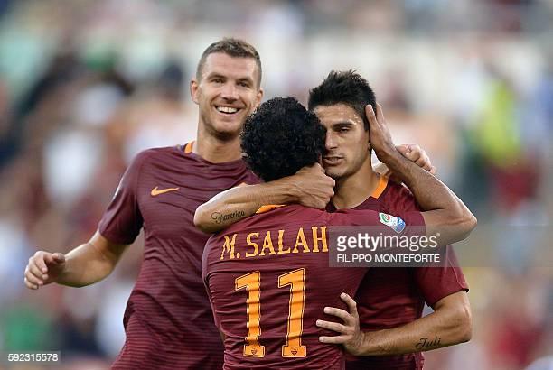 Roma's Argentinian midfielder Diego Perotti celebrates with his teammates Egyptian midfielder Mohamed Salah and Macedonian forward Edin Dzeko during...