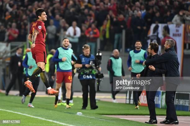 Roma's Argentinian midfielder Diego Perotti celebrates with Roma's Italian head coach Eusebio Di Francesco after scoring during the UEFA Champions...