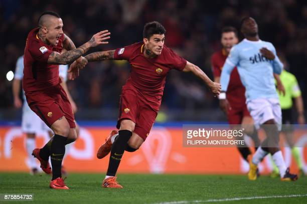 Roma's Argentinian midfielder Diego Perotti celebrates with teammate Roma's Belgian midfielder Radja Nainggolan after scoring a penalty during the...