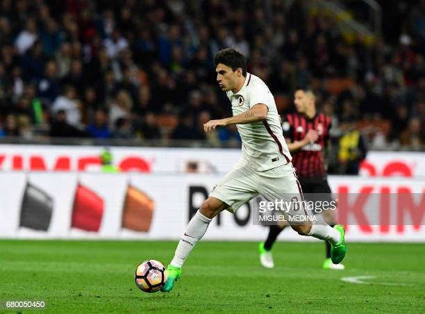 AS Roma's Argentinian midfielder Diego Perotti controls the ball during the Italian Serie A football match AC Milan vs AS Roma at the San Siro...