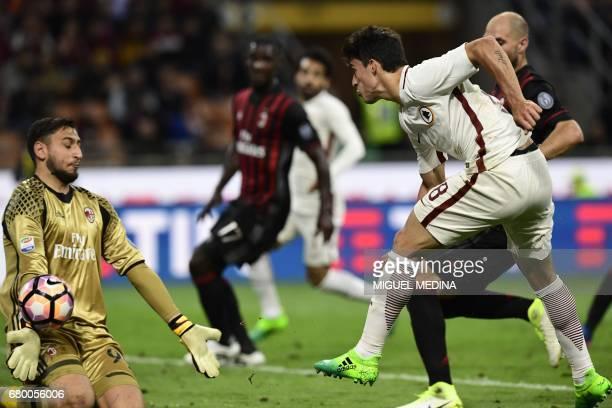 AS Roma's Argentinian midfielder Diego Perotti kicks the ball during the Italian Serie A football match AC Milan vs AS Roma at the San Siro stadium...