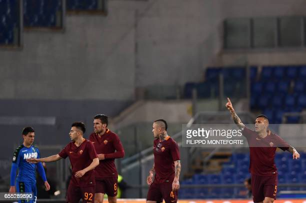 Roma's Argentinian midfielder Leandro Paredes celebrates after scoring during the italian Serie A football match Roma vs Sassuolo at the Olympic...