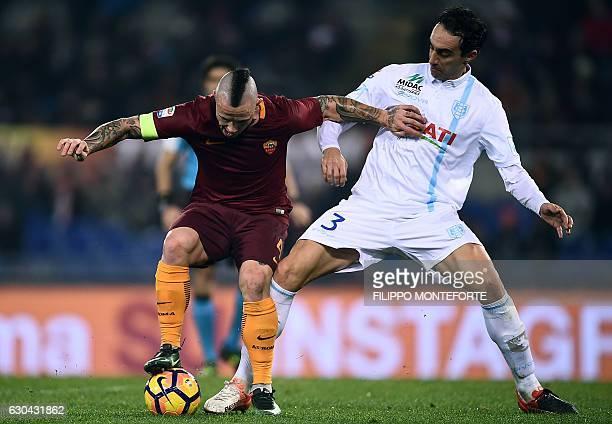 Roma's Belgiab midfielder Radja Nainggolan vies with Chievo defender Dario Dainelli during the italian Serie A football match between Roma and Chievo...
