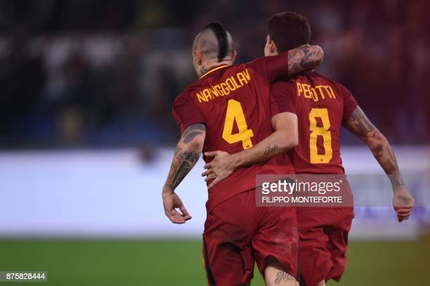 Roma's Belgian midfielder Radja Nainggolan and Roma's Argentinian midfielder Diego Perotti celebrate after scoring during the Italian Serie A...