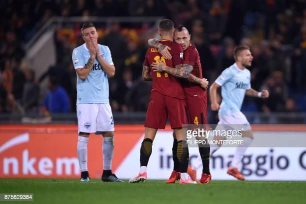 Roma's Belgian midfielder Radja Nainggolan and Roma's Croatian defender Aleksandar Kolarov celebrate after scoring as Lazio's midfielder from Serbia...