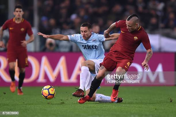 Roma's Belgian midfielder Radja Nainggolan fights for the ball with Lazio's midfielder from Montenegro Adam Marusic during the Italian Serie A...