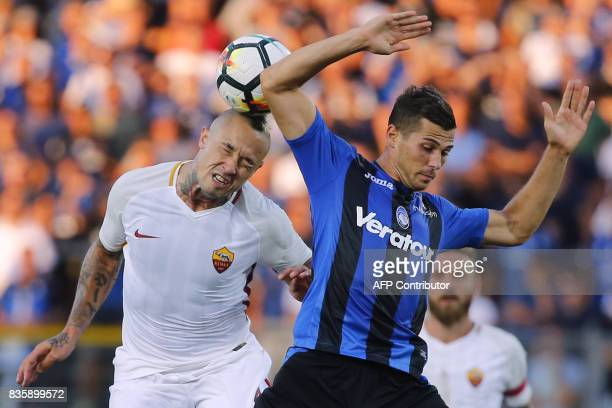 AS Roma's Belgian midfielder Radja Nainggolan jumps for the ball with Atalanta's Switzerland's midfielder Remo Freuler during the Italian Serie A...