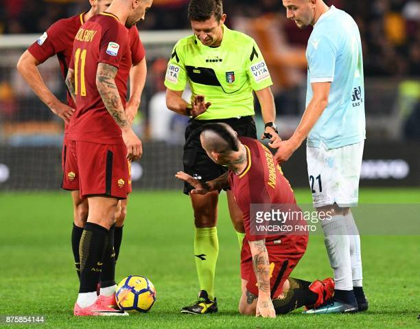 Roma's Belgian midfielder Radja Nainggolan reacts during the Italian Serie A football match AS Roma vs Lazio on November 18 2017 at the Olympic...