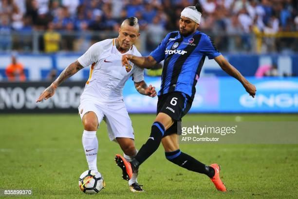 AS Roma's Belgian midfielder Radja Nainggolan vies for the ball with Atalanta's Bosnian defender Ervin Zukanovic during the Italian Serie A football...