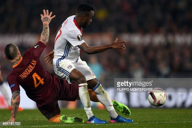Roma's Belgian midfielder Radja Nainggolan vies with Lyon's French forward Maxwel Cornet during the Europa League Round of 16 return football match...
