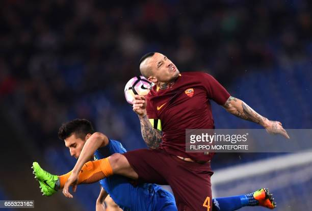 Roma's Belgian midfielder Radja Nainggolan vies with Sassuolo's defender Luca Antei during the italian Serie A football match Roma vs Sassuolo at the...