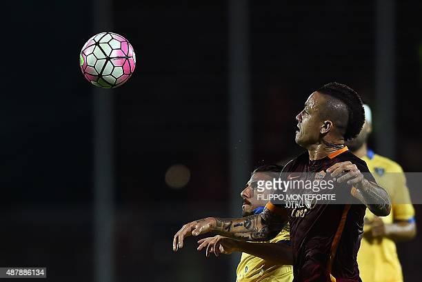 Roma's Belgian midfielder Radja Nianggolan vies with Frosinone's forward Daniele Verde during the Italian Serie A football match between Frosinine...