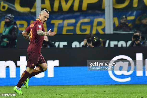 AS Roma's Belgium midfielder Radja Nainggolan celebrates after scoring a goal during the Italian Serie A football match Inter Milan vs AS Roma at the...