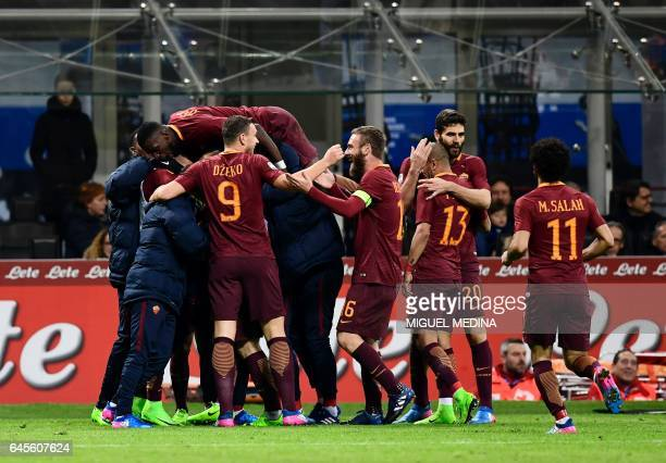 AS Roma's Belgium midfielder Radja Nainggolan is congratulated by teammates after scoring his second goal during the Italian Serie A football match...