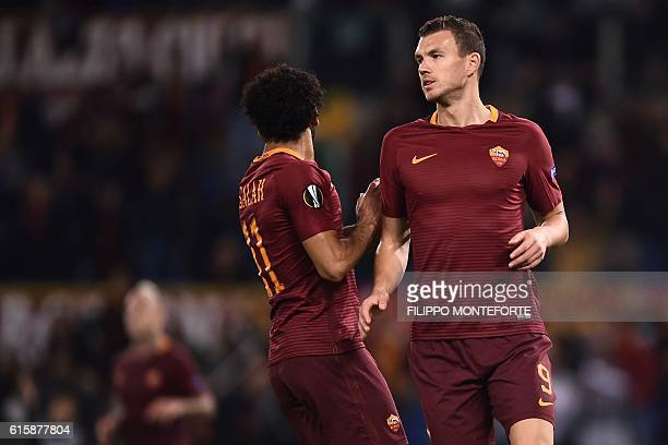 Roma's Bosnian forward Edin Dzeko and Roma's Egyptian midfielder Mohamed Salah react during the Europa League Group E football match between Roma and...
