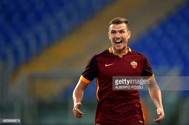 Roma's Bosnian forward Edin Dzeko celebrates after scoringn goal during the friendly football match AS Roma vs Sevilla on August 14 2015 at the...