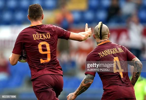 AS Roma's Bosnian forward Edin Dzeko celebrates next to AS Roma's Belgian midfielder Radja Nainggolan after scoring a goal during the Italian Serie A...