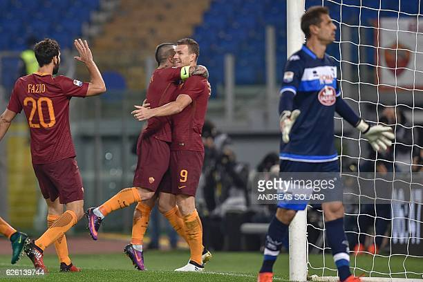 AS Roma's Bosnian forward Edin Dzeko celebrates with his teammates after scoring during the Italian Serie A football match between AS Roma and...