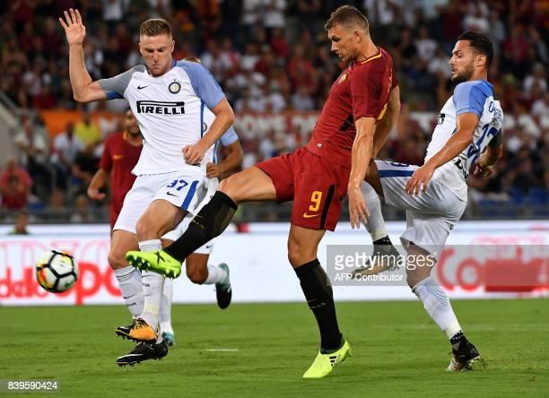 AS Roma's Bosnian forward Edin Dzeko scores a goal during the Italian Serie A football match Roma vs Inter Milan on August 26 2017 at Olympic stadium...