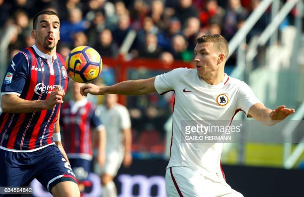Roma's Bosnian forward Edin Dzeko vies for the ball with Crotone's Belgian defender Noe Dussenne during the Italian Serie A football match FC Crotone...