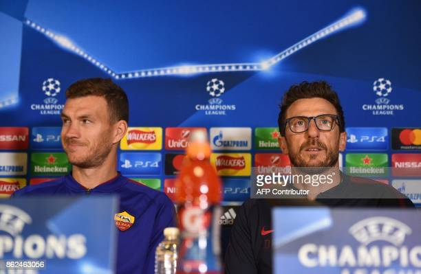 Roma's Bosnian striker Edin Dzeko and Roma's Italian head coach Eusebio Di Francesco attend a press confernce in London on October 17 on the eve of...