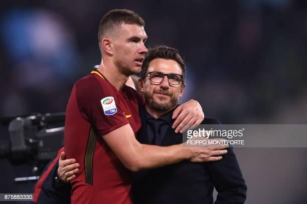 Roma's Bosnian striker Edin Dzeko and Roma's Italian head coach Eusebio Di Francesco celebrate at the end of the Italian Serie A football match AS...