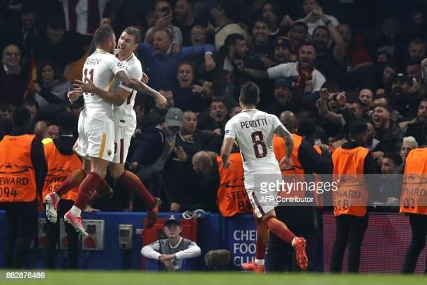 Roma's Bosnian striker Edin Dzeko celebrates after scoring his second goal with Roma's Croatian defender Aleksandar Kolarov during a UEFA Champions...
