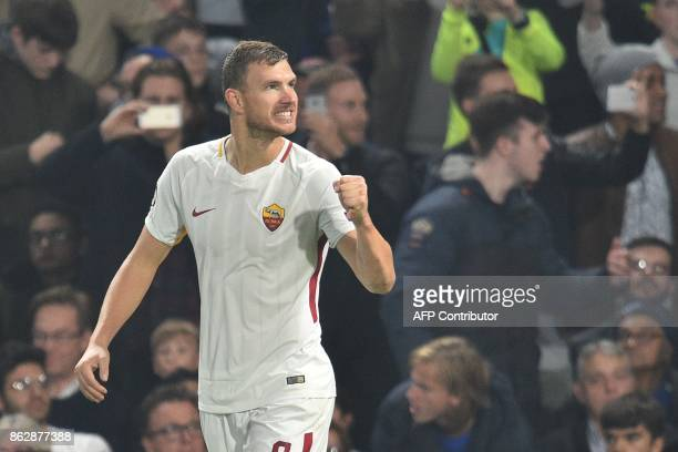 Roma's Bosnian striker Edin Dzeko celebrates after scoring his second goal during a UEFA Champions league group stage football match between Chelsea...