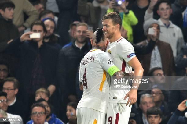 Roma's Bosnian striker Edin Dzeko celebrates after scoring his second goal with Roma's Belgian midfielder Radja Nainggolan during a UEFA Champions...