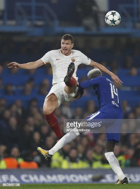 Roma's Bosnian striker Edin Dzeko vies with Chelsea's French midfielder Tiemoue Bakayoko during a UEFA Champions league group stage football match...