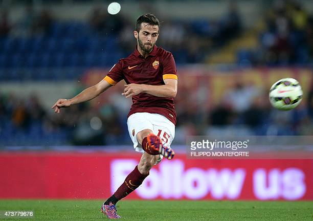 Roma's BosnianHerzegovian midfielder Miralem Pjanic shoots a free kick during the Serie A football match between Roma and Udinese on May 17 2015 at...